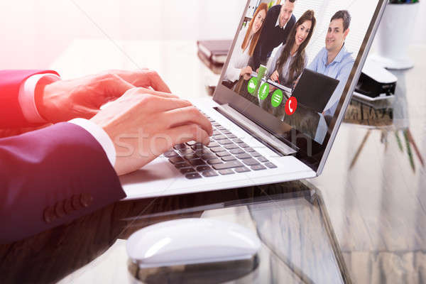 Businessperson Video Conferencing On Laptop Stock photo © AndreyPopov