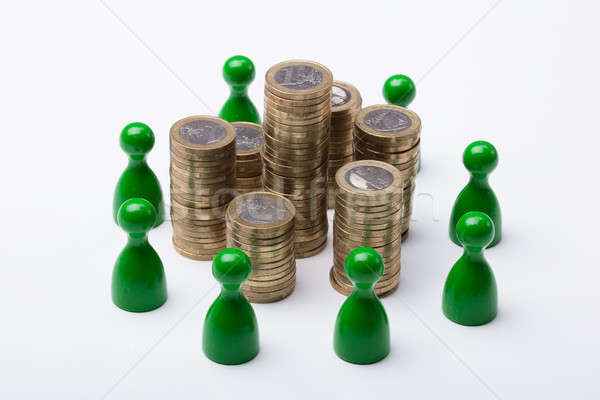 Coin Stack Surrounded With Green Figures Stock photo © AndreyPopov