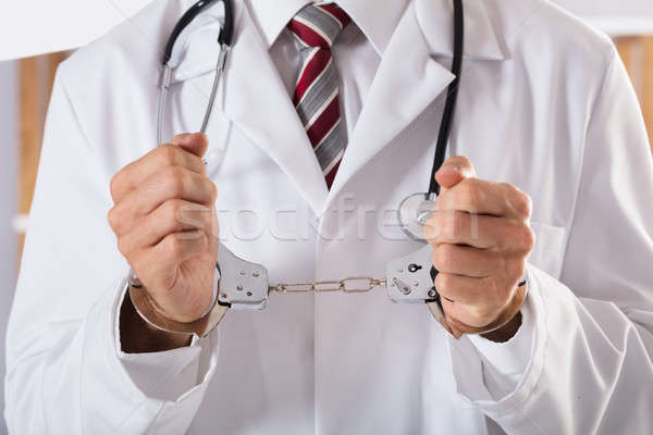 Close-up Of Arrested Doctor's Hand Stock photo © AndreyPopov