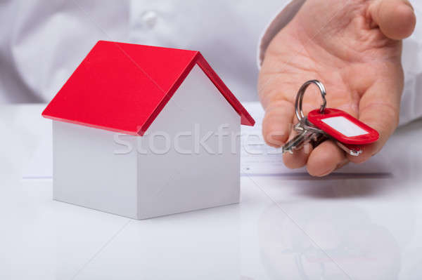 Hand Holding House Keys With House Model Stock photo © AndreyPopov
