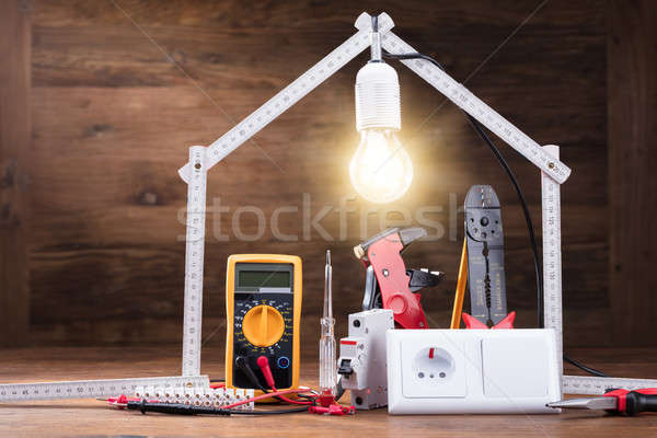 Repair Tools Under The Illuminated House Stock photo © AndreyPopov