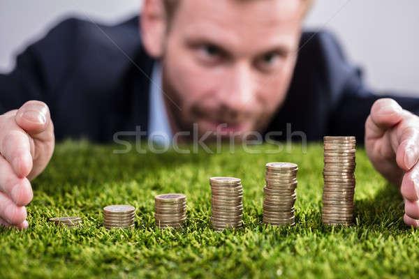 üzletember egymásra pakolva érmék fű közelkép kéz Stock fotó © AndreyPopov