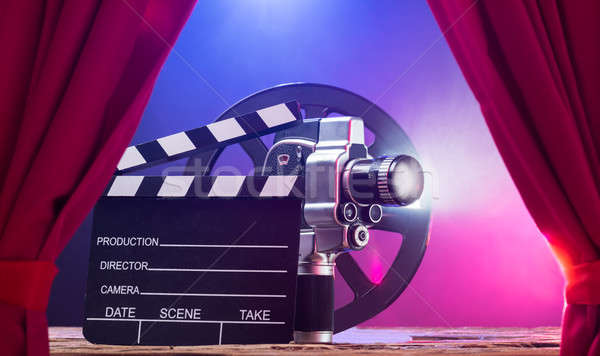 Movie Camera With Clapperboard And Film Reel On Stage Stock photo © AndreyPopov