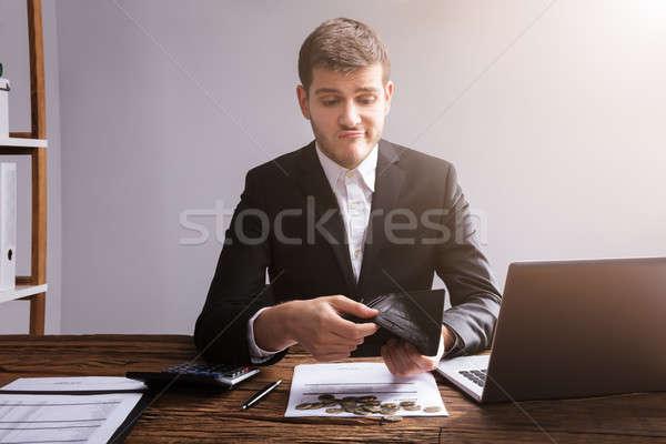 печально бизнесмен бумажник служба монетами ноутбука Сток-фото © AndreyPopov