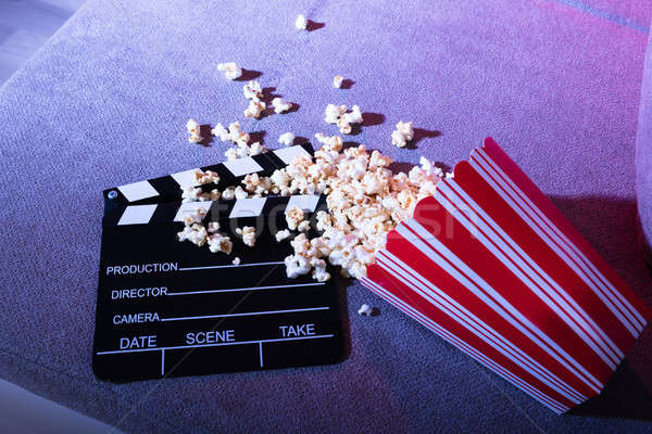 Elevated View Of Spilled Popcorn And Clapperboard Stock photo © AndreyPopov