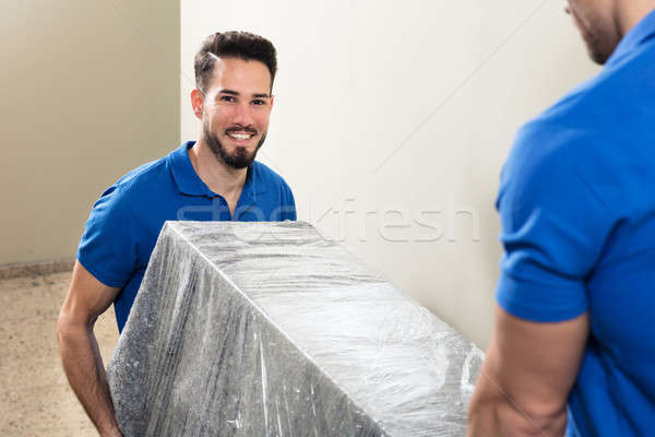 Two Movers Carrying Furniture On Staircase Stock photo © AndreyPopov