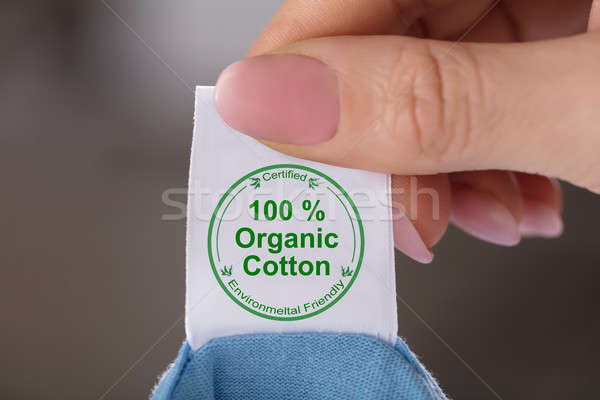 Person Holding Label Showing 100 Percent Organic Cotton Stock photo © AndreyPopov