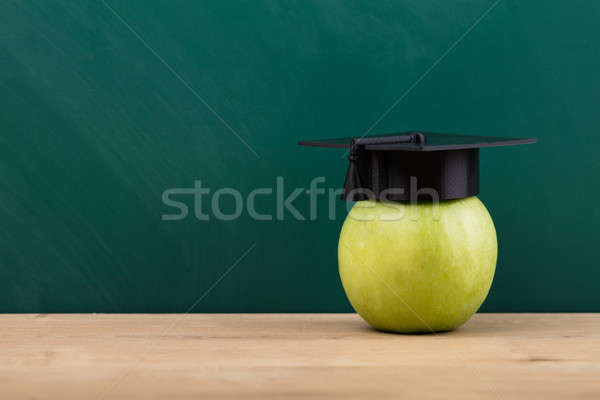 Close-up Of A Green Apple With Graduation Hat Stock photo © AndreyPopov