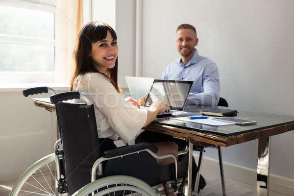 счастливым инвалидов деловая женщина рабочих ноутбука партнера Сток-фото © AndreyPopov