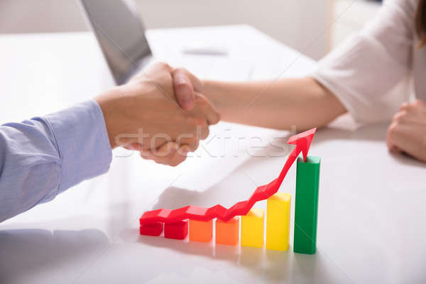 Close-up Of Increasing Multi Colored Graph With Red Arrow Stock photo © AndreyPopov