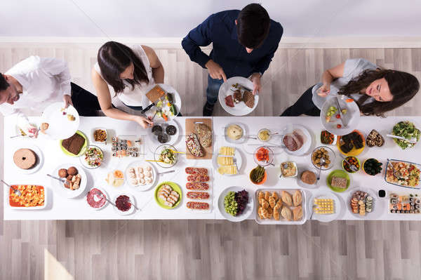 Group Of People Eating Food On Plate Stock photo © AndreyPopov