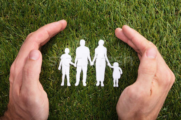 Human Hand Protecting Family Paper Cut Out Stock photo © AndreyPopov