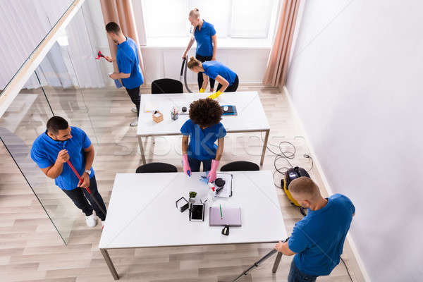 Janitors In Uniform Cleaning Office Stock photo © AndreyPopov