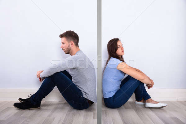 Unhappy Young Couple Sitting Back To Back Stock photo © AndreyPopov