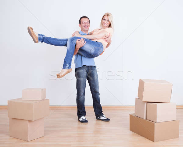 Portrait Of Husband Holding Wife In New Home Stock photo © AndreyPopov