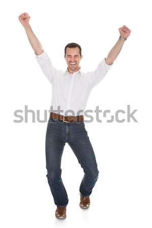 Portrait Of Man With Arm Raised Stock photo © AndreyPopov