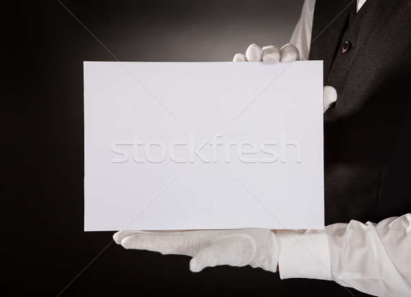 Young Waiter Holding Blank Placard Stock photo © AndreyPopov