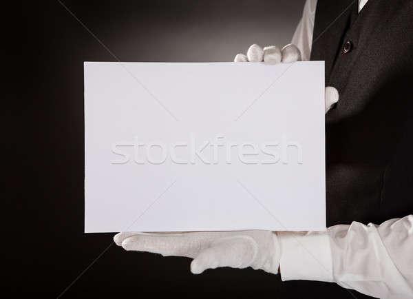 Fiatal pincér tart plakát közelkép bemutat Stock fotó © AndreyPopov