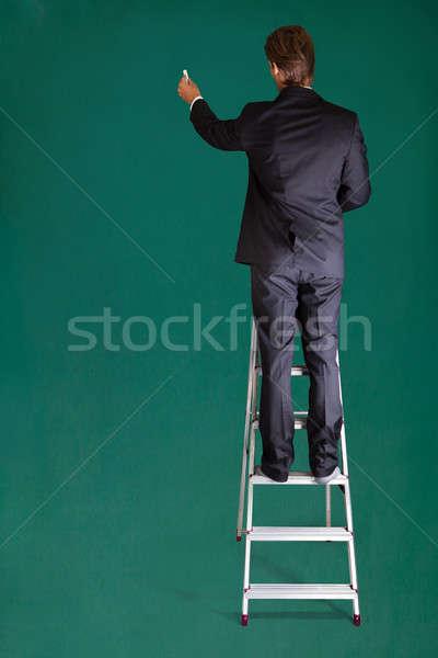 бизнесмен Постоянный лестнице Дать доске вид сзади Сток-фото © AndreyPopov