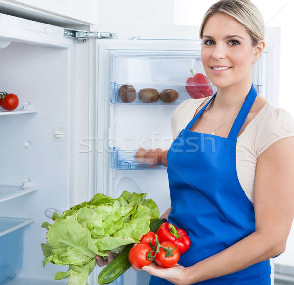 Woman In Apron Holding Bottle Stock photo © AndreyPopov