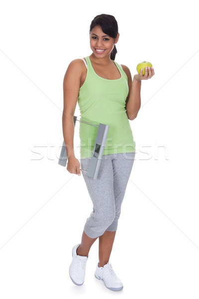 Portrait Of Woman Holding A Weighing Scale And An Apple Stock photo © AndreyPopov