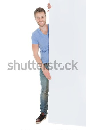 Young man holding out his hand in greeting Stock photo © AndreyPopov