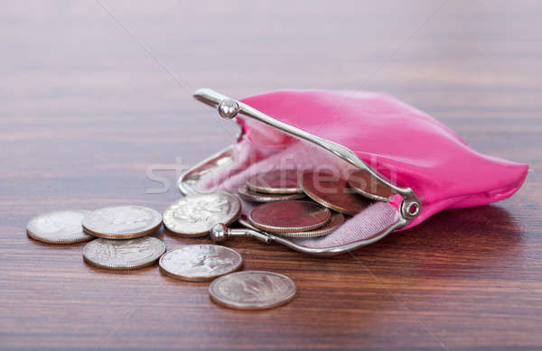 Coins Spilled From Purse On Table Stock photo © AndreyPopov