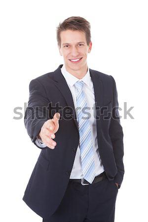 Stock photo: Portrait Of A Businessman Offering Handshake