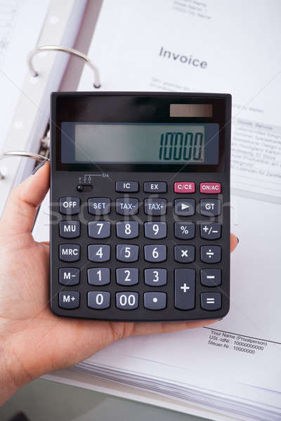 Accountant Holding Calculator Stock photo © AndreyPopov