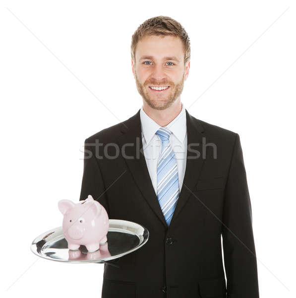 Businessman With Piggybank On Tray Stock photo © AndreyPopov