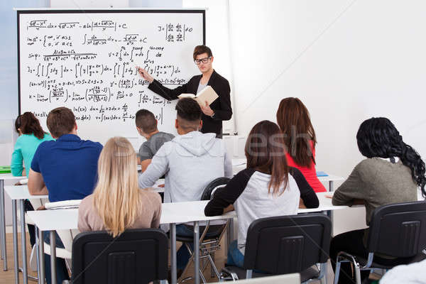 Teacher Teaching Math Formulas To College Students Stock photo © AndreyPopov