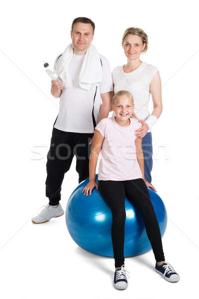 Young Family Standing In Fitness Outfit Stock photo © AndreyPopov