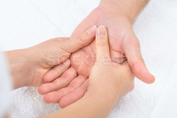 Physiotherapist Massaging Palm Stock photo © AndreyPopov