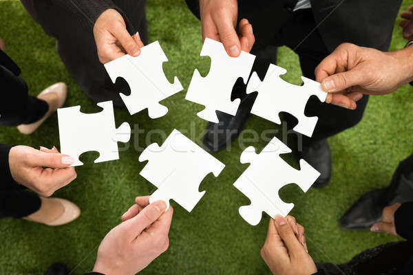 Businesspeople Hands With Jigsaw Puzzle Stock photo © AndreyPopov