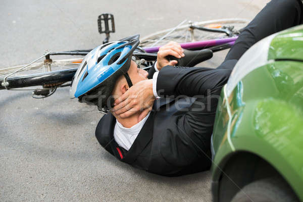 Male Cyclist After Car Accident Stock photo © AndreyPopov