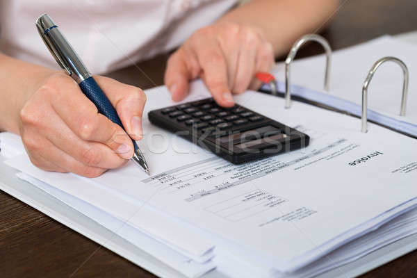 Accountant Doing Calculation Stock photo © AndreyPopov