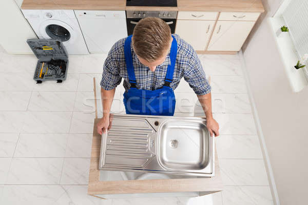 Plumber Fixing Stainless Steel Sink Stock photo © AndreyPopov