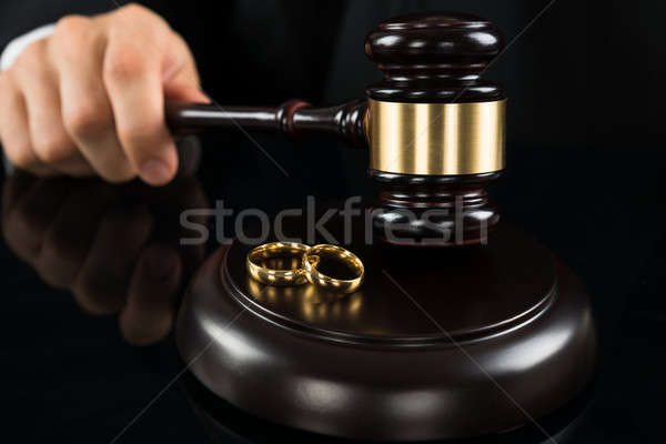 Stock photo: Close-up Of Judge Hitting Gavel With Rings
