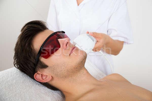 Férfi lézer haj eltávolítás kezelés fiatalember Stock fotó © AndreyPopov