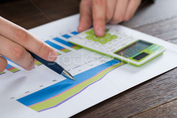Person Hands Analyzing Financial Report Stock photo © AndreyPopov