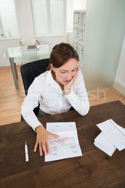 Empresária documento escritório olhando secretária Foto stock © AndreyPopov
