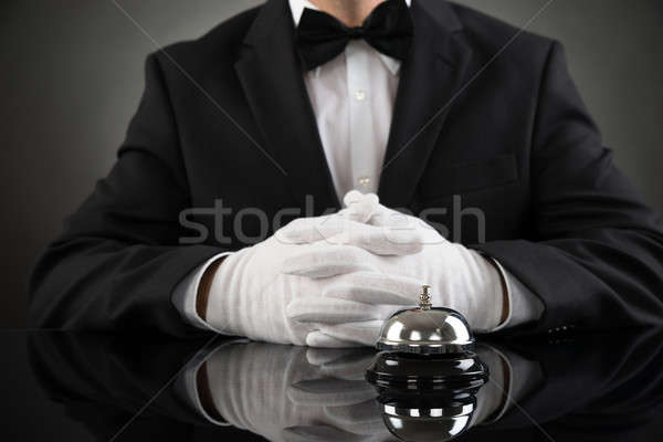 Waiter With Service Bell At Desk Stock photo © AndreyPopov