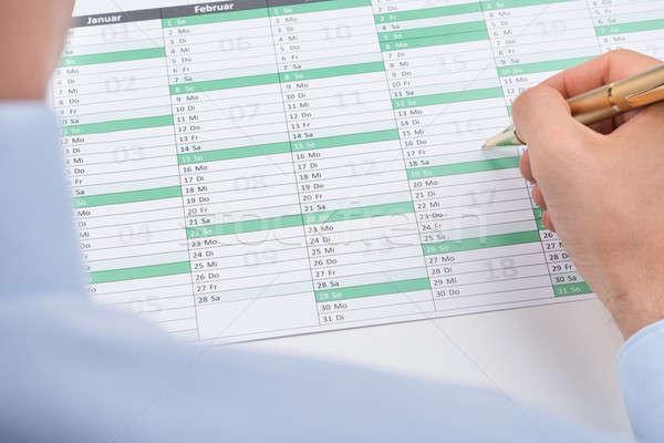 Businessperson Marking On Calendar Stock photo © AndreyPopov