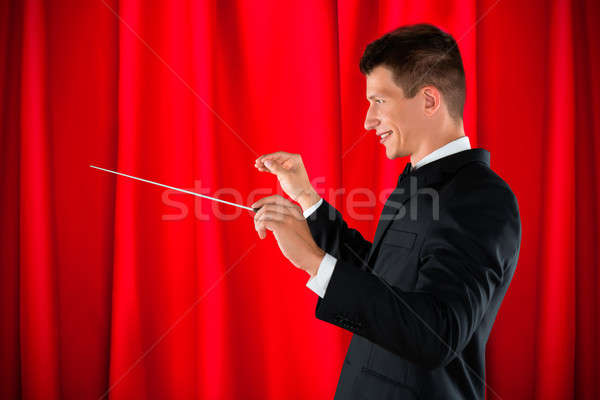 Orchestre Homme rouge rideau homme Photo stock © AndreyPopov
