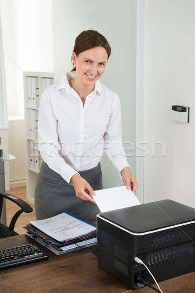 Titkárnő papír nyomtató fiatal női asztal Stock fotó © AndreyPopov
