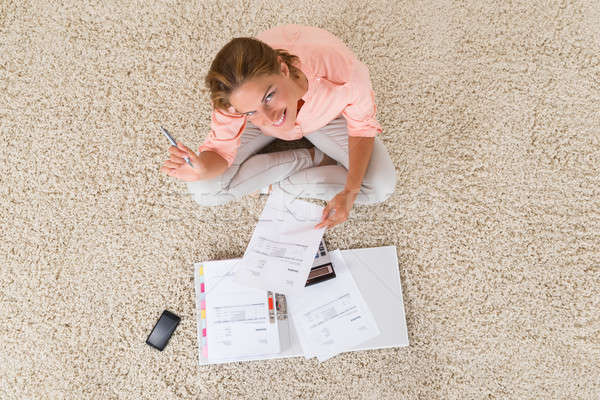Woman Doing Calculation Stock photo © AndreyPopov