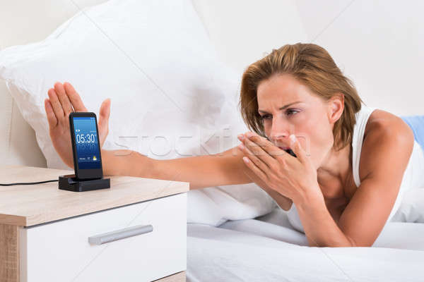 Mulher alarme mulher jovem telefone móvel telefone Foto stock © AndreyPopov