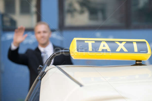 Businessman Catching Taxi Stock photo © AndreyPopov
