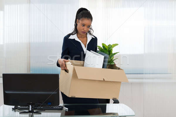 Businesswoman Carrying Box With Her Belongings Stock photo © AndreyPopov