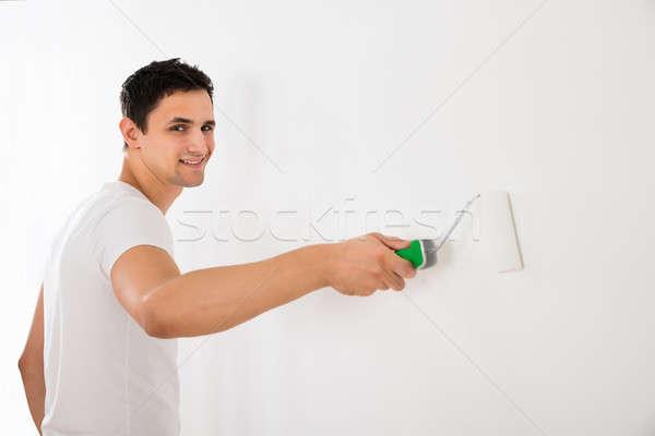 Stockfoto: Man · verf · muur · jonge · man · witte · home